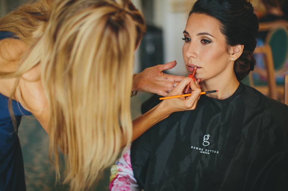 Gemma applies lip liner to bride for her wedding hair and makeup trial