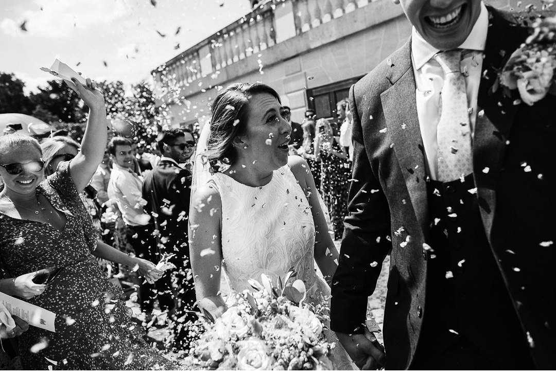 Bride & Groom, Kate and Karl Step out of Botleys Mansion to a  to a reception of cenfetti from their gusts, bridal hair up-do and soft natural makeup by Miss Sunshine of the Gemma Sutton Pro Team