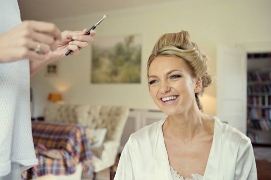 Bride getting ready with her gorgeous up do