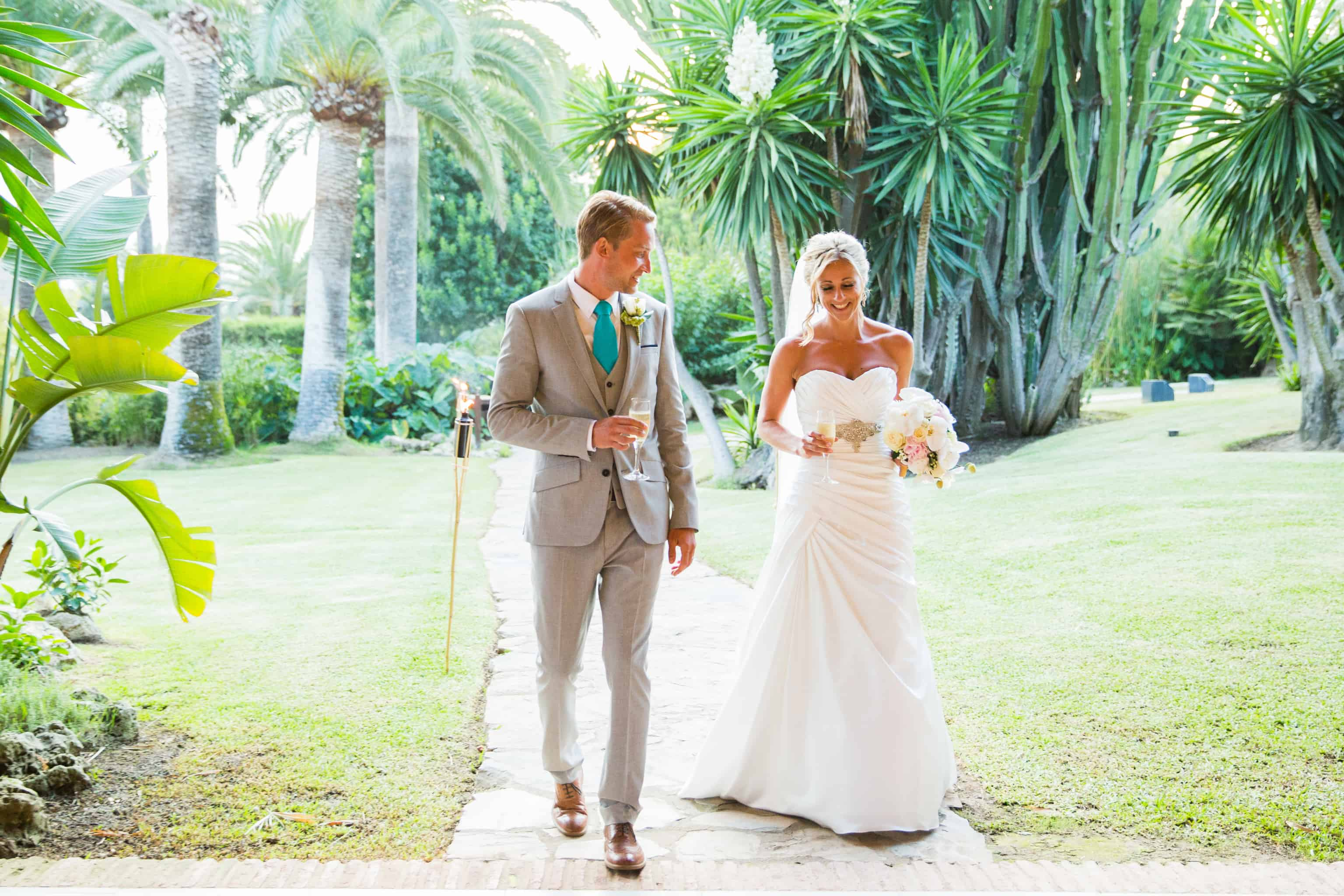 A Tropical Paradise backdrop for the Bride and groom at their Marbella Wedding