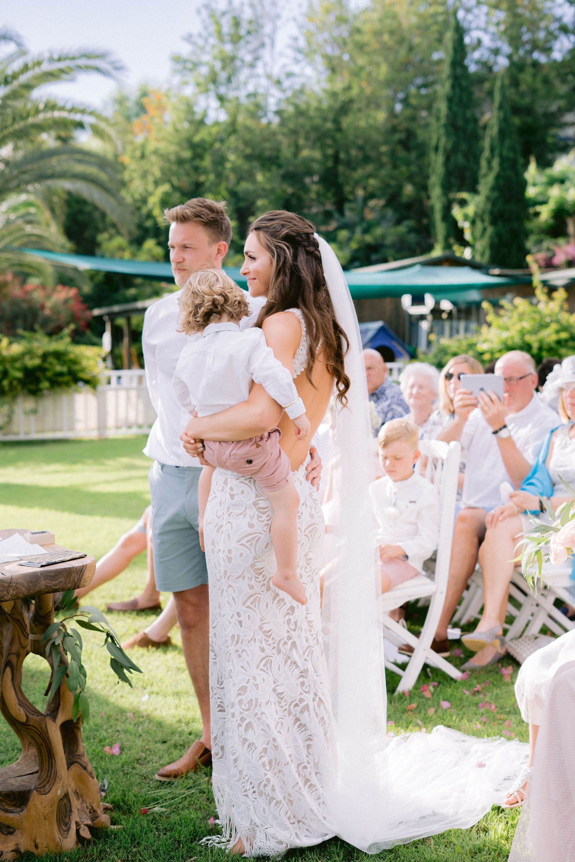 A touching moment where little Harrison joinging his mummy, beautiful bride Fran for her wedding vows, Fran wears a stunning lace dress from Grace Loves Lace