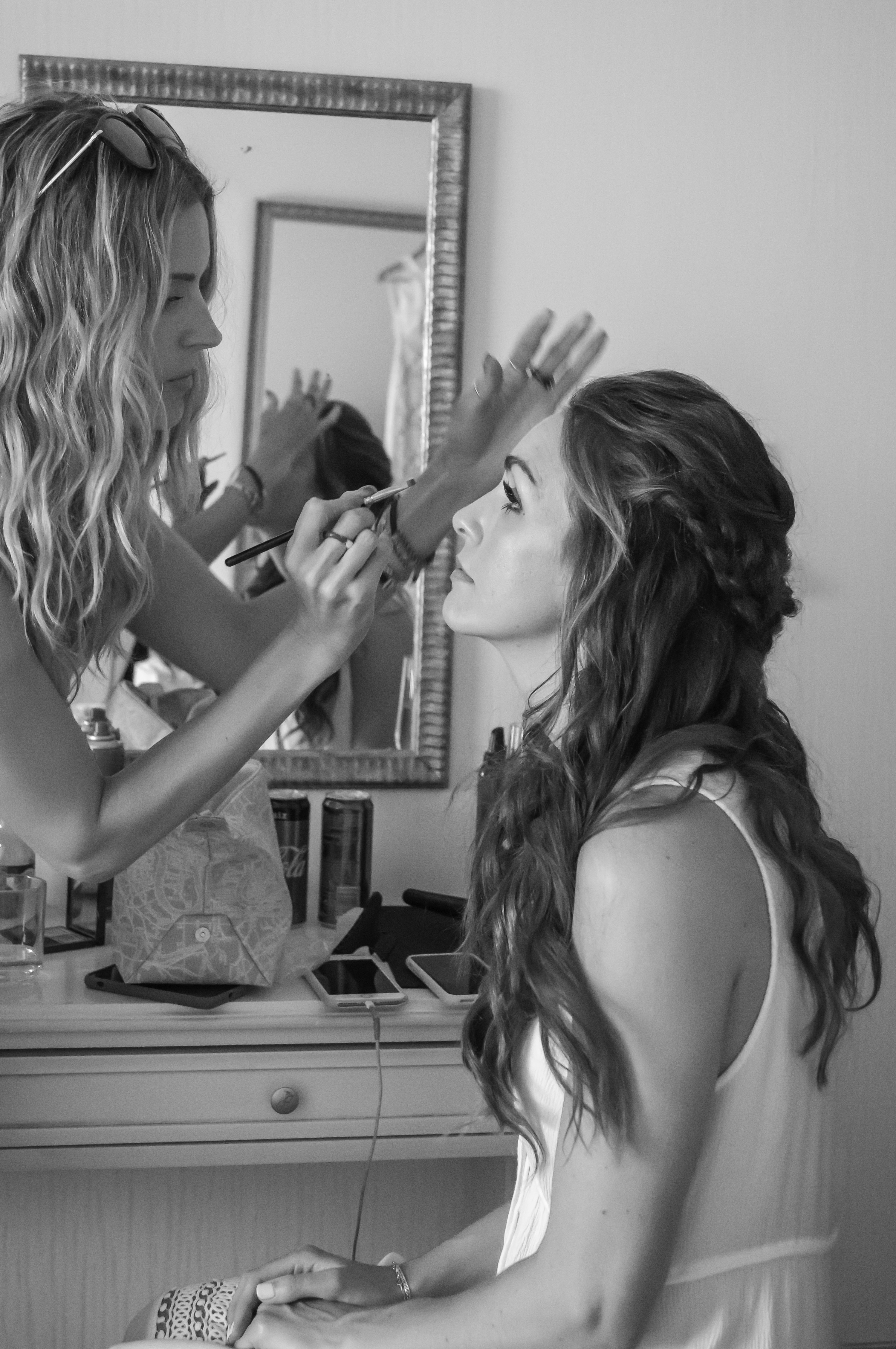 Gemma Sutton applies makeup to stunning brunette bride Fran who has a half up half down hair