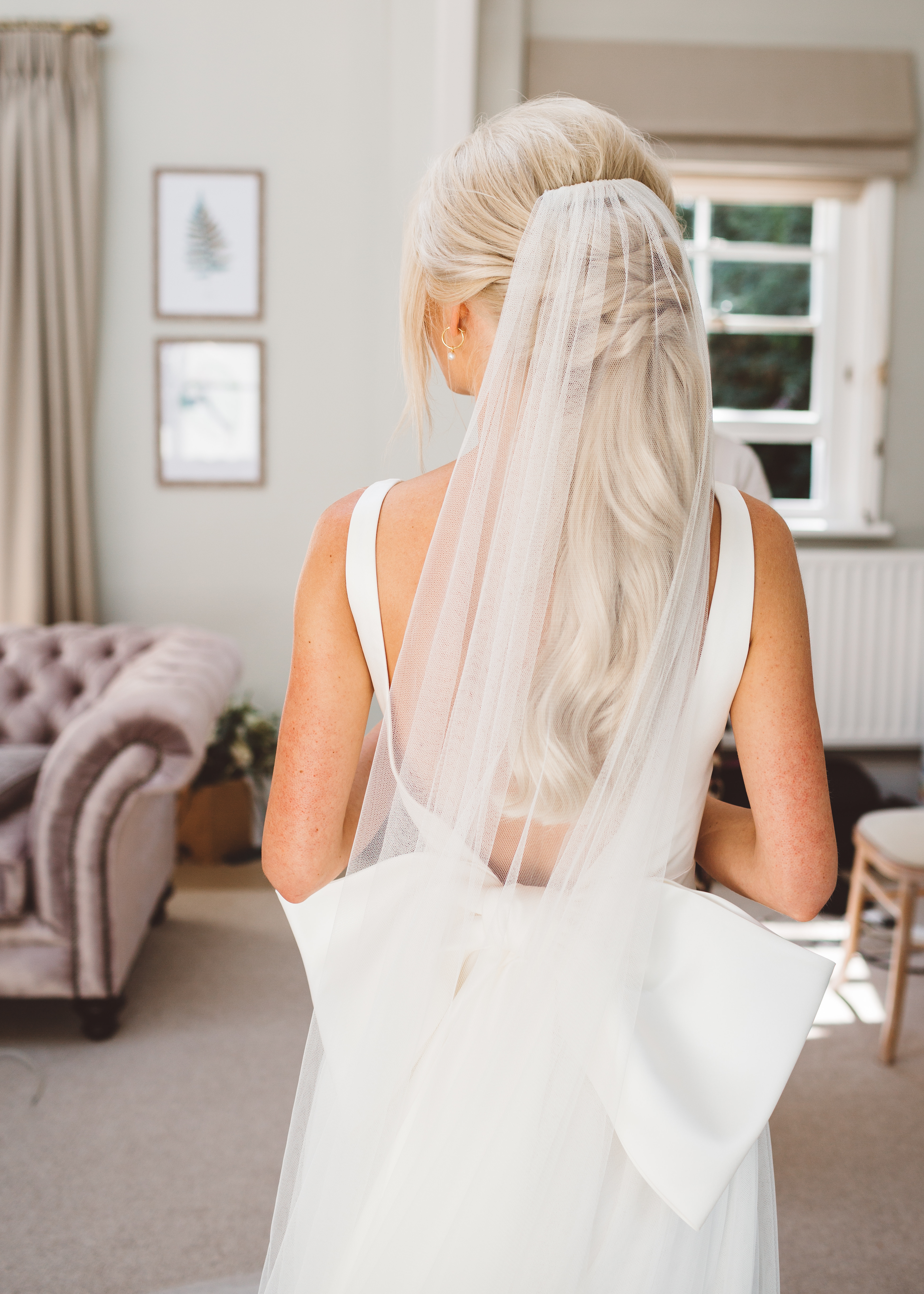 bride and her big beautiful bowed wedding dress