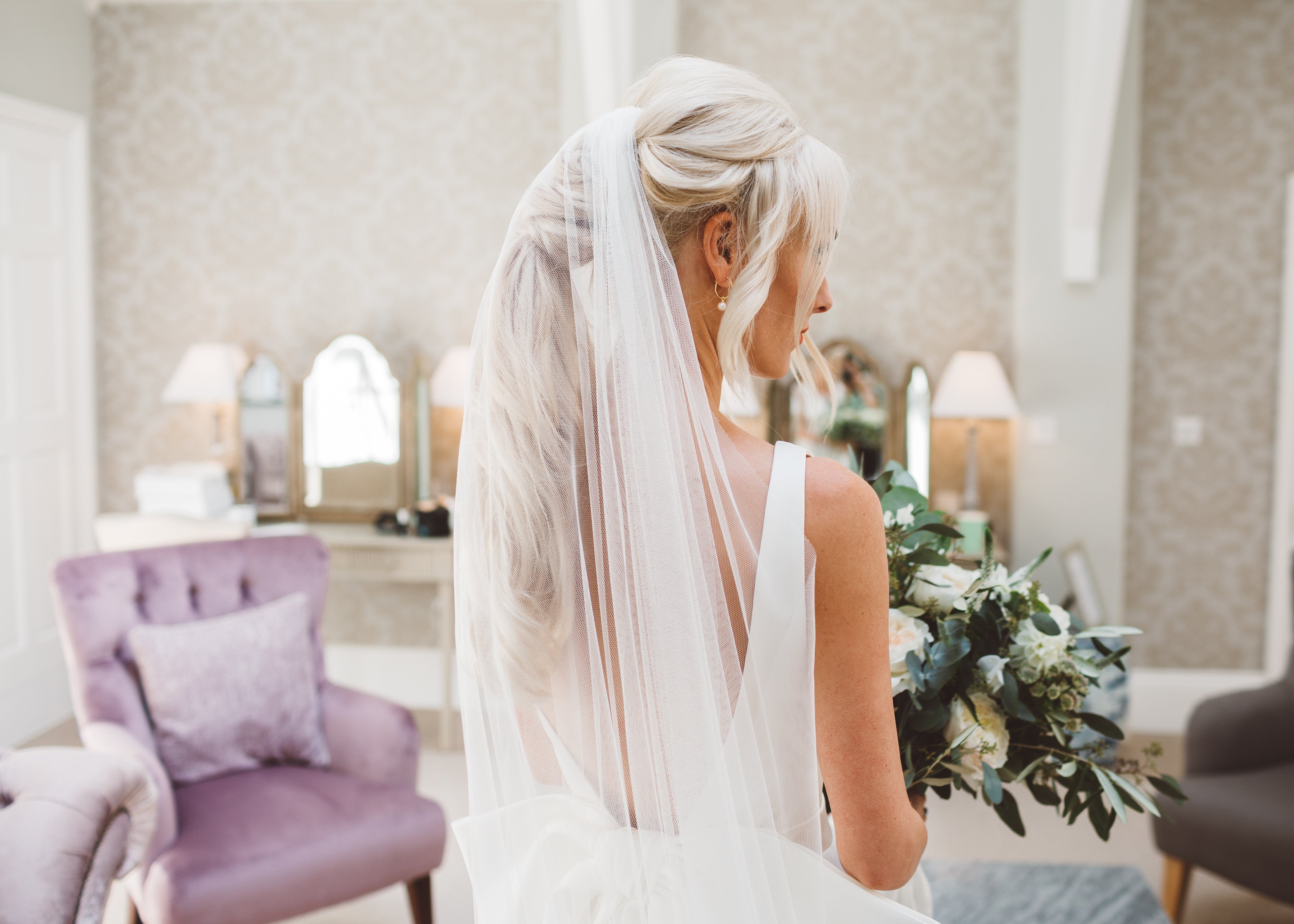 bride ready to get married with a stunning veil and statement ponytail