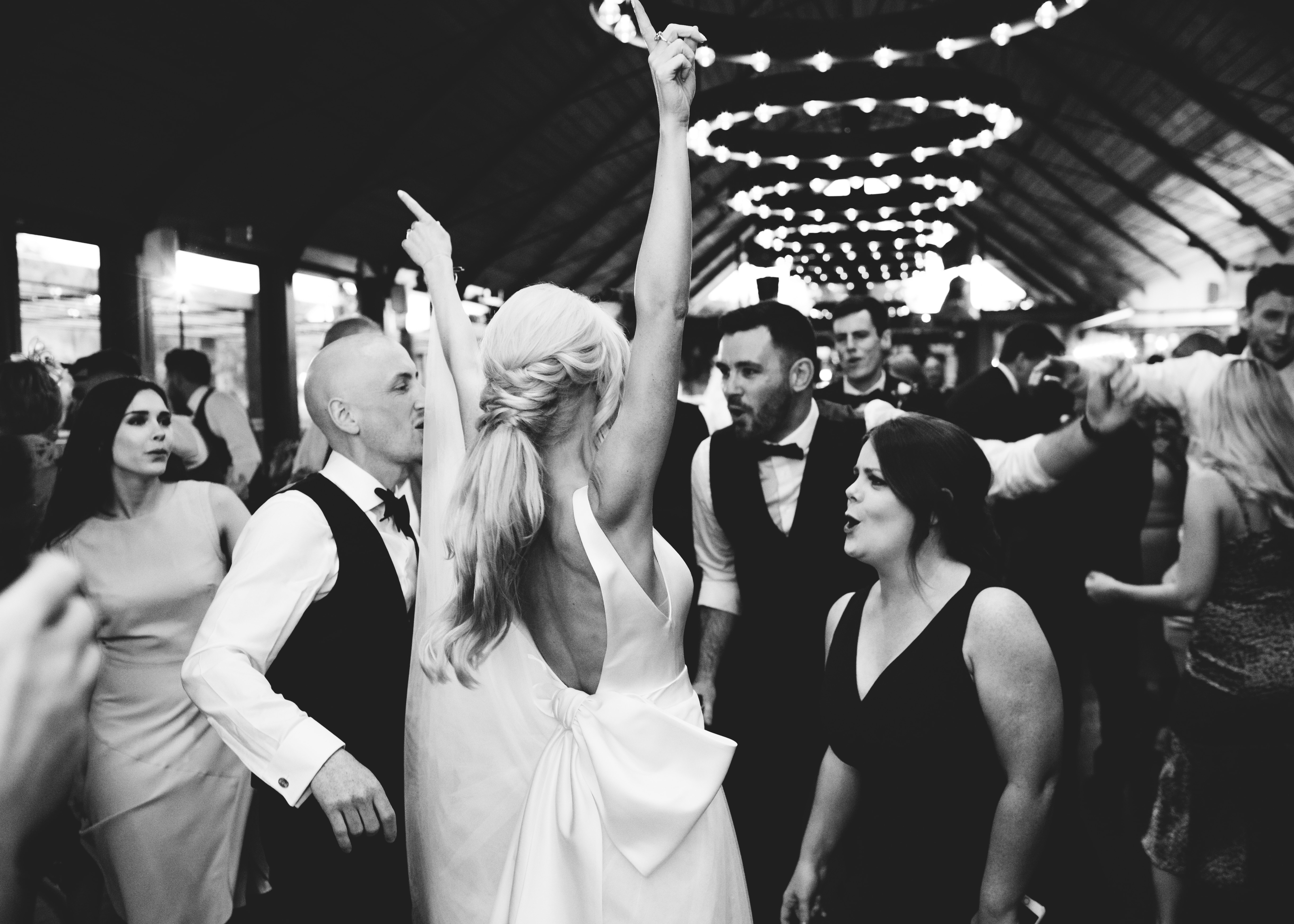 bride and groom party on the dancefloor with their guests